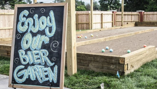 The Bier Garten features multiple bocce courts and cornhole games at Blind Owl Brewery.
