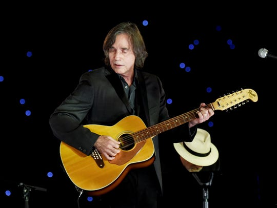 Jackson Browne performs at the Los Angeles Convention Center in this 2015 file photo.