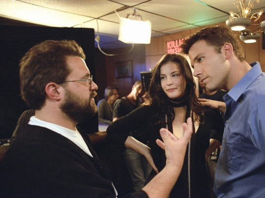 """Director Kevin Smith, left, gestures toward actors Liv Tyler, center, and Ben Affleck between shooting scenes from Miramax's """"Jersey Girl"""" in 2004. Smith appears Friday at Higher Ground."""