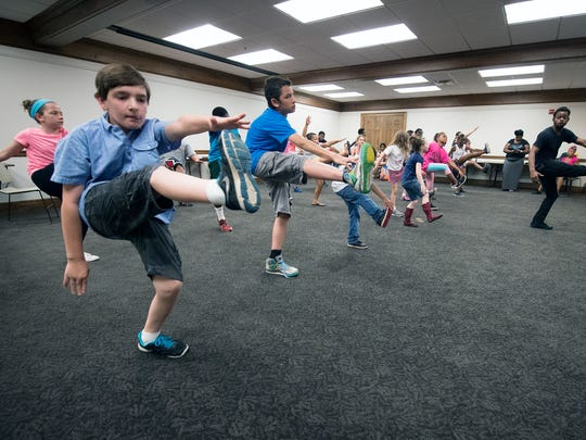 Kids learn dance moves with Illstyle and Peace Productions at Martin Library, with Steven Gates in the lead, at right. The library is holding several weeks of free dance camp for kids in grades four, five and six.