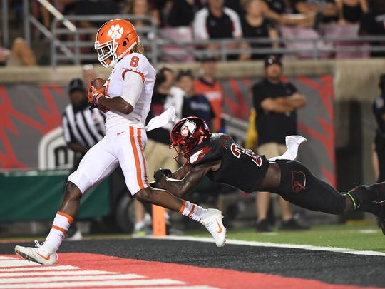 Clemson wide receiver Deon Cain (8) catches a TD past Louisville cornerback Ronald Walker (20) during the 2nd quarter on Saturday, September 16, 2017 at Louisville's Papa John's Cardinal Stadium. The play was called back due to an offside call against Clemson.