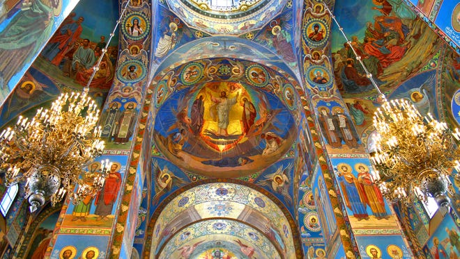 The Church of the Savior on the Spilled Blood in St. Petersburg, Russia, has ornate ceilings depicting Biblical scenes.