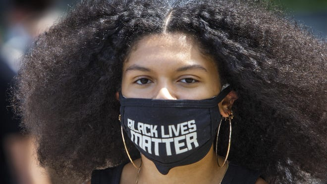 Black Live Matter organizer Madeliene Smith leads the March through Eugene on Sunday. [Chris Pietsch/The Register-Guard] - registerguard.com