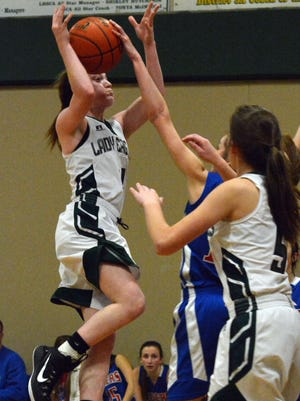 Menard's Maddie Smith (4, left) goes up for a shot in the Lady Eagles' loss to Lake Arthur during the second round of the playoffs Tuesday night. Smith led Menard with nine point.