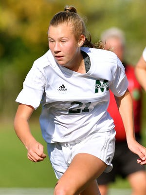 Abby Wesselkamper makes a play on a loose ball for McNicholas.