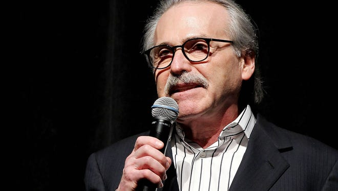In this Jan. 31, 2014 photo, David Pecker, Chairman and CEO of American Media, addresses those attending the Shape & Men's Fitness Super Bowl Party in New York. The Aug. 21, 2018 plea deal reached by Donald Trump's former attorney Michael Cohen has laid bare a relationship between the president and Pecker, whose company publishes the National Enquirer. Besides detailing tabloid's involvement in payoffs to porn star Stormy Daniels and Playboy Playmate Karen McDougal to keep quiet about alleged affairs with Trump, court papers showed how David Pecker, a longtime friend of the president, offered to help Trump stave off negative stories during the 2016 campaign. (Marion Curtis via AP) ORG XMIT: NYR105