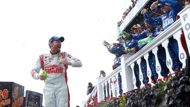 Crew members shower Dale Earnhardt Jr. in victory lane after his victory in Sunday's GoBowling.com 400 at Pocono Raceway.