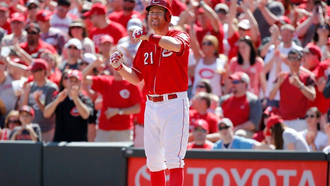 Reds third baseman Todd Frazier celebrates a two-run single against the Cardinals on April 12.