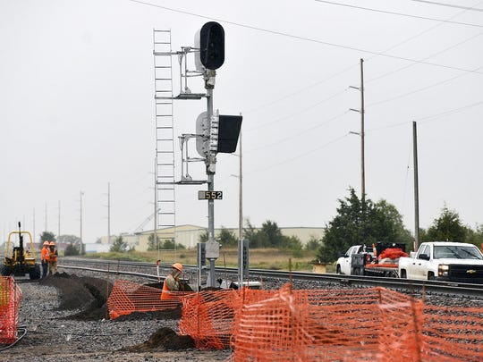 A crew works along the BNSF Railway tracks Wednesday in Becker. BNSF is adding a double railroad track between Becker and Big Lake and by Little Falls.