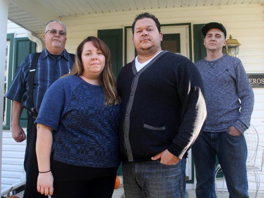 From left, James Weldon, his daughter Sharon Caminero, her husband Hamlet, and her brother Brian Weldon, pose outside the Camineros' home in Groveville, N.J.. The family is in the midst of a custody battle with Dutchess County over Brian's daughter Molly, 27 months.