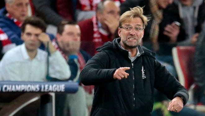 Liverpool manager Jurgen Klopp gives directions to his players during the Champions League match against Spartak Moscow in Moscow, Russia.