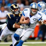 Rams defensive tackle Aaron Donald sacks Lions quarterback Matthew Stafford in the fourth quarter Sunday in St. Louis.