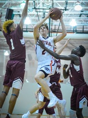 Central York's leading scorer Garrett Markey, center, seen here during a Feb. 6 game against New Oxford, will lead the Panthers into battle as they take on the Colonials for the third time this season. Their match-up Tuesday night at Red Lion is a York-Adams League tournament semifinal contest.