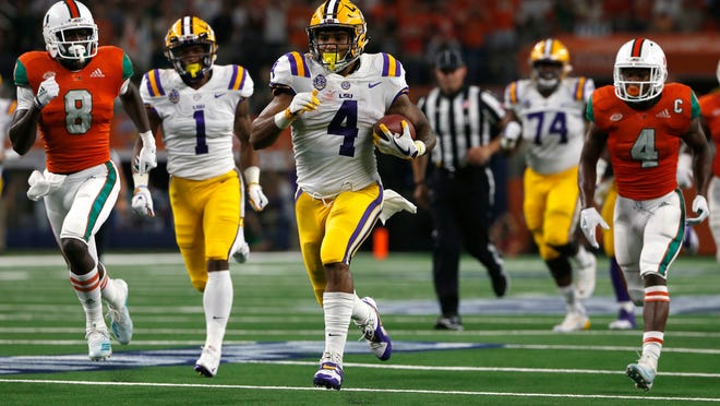 LSU running back Nick Brossette (4) runs for a touchdown as Miami defensive backs DJ Ivey (8) and Jaquan Johnson (4) give chase during the first half of an NCAA college football game Sunday, Sept. 2, 2018, in Arlington, Texas. (AP Photo/Ron Jenkins)