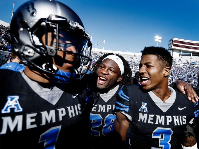 Memphis teammates Doroland Dorceus (middle) and Anthony