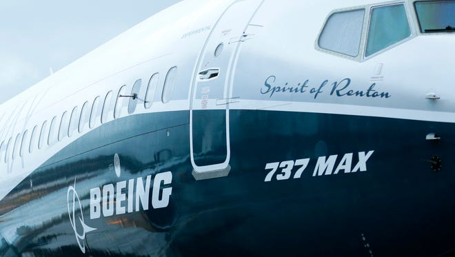 The first Boeing 737 MAX airplane to roll off Boeing's assembly line in Renton, Wash., is shown Dec. 8, 2015, before an employee-only rollout event.