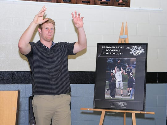 With the Plymouth Hall of Fame photo as a guide, Brennen