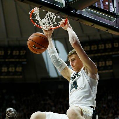 Isaac Haas of Purdue throws down a dunk against  Minnesota