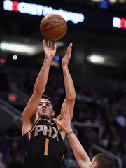 Devin Booker puts up a shot against the Hawks during a game Feb. 2 at Talking Stick Resort Arena.