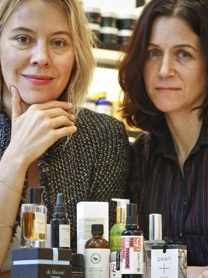 Kerrilynn Pamer, left, and Cindy DiPrima Morisse, owners of CAP Beauty, a wellness store with an all-things-natural approach, pose with products sold at their store in New York's West Village.