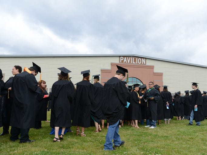 Graduates prepare to make their entrance during the 58th Chemeketa Community College commencement ceremony at The Pavilion at the Oregon State Fairgrounds in Salem on Tuesday, June 17, 2014.