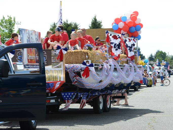 Participants wait for the Stayton Fourth of July parade to begin on Friday, July 4, 2014.