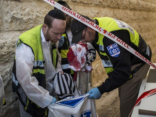 Israeli emergency personnel remove bloody clothing