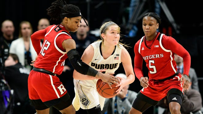 Rutgers Scarlet Knights guard Khadaizha Sanders (12) steals the ball from Purdue Boilermakers guard Karissa McLaughlin (1) in the second half during the second round of the Big Ten Conference Tournament at Bankers Life Fieldhouse. Rutgers defeated Purdue 62-60.