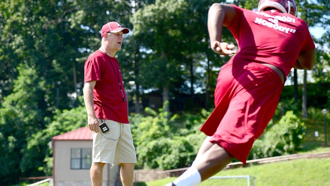 Asheville High football coach David Burdette and the Cougars improved to 2-3 with Friday's win over visiting Winston-Salem Carver.