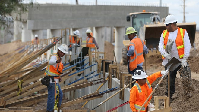 Construction workers recently worked on the Carolina Bridge in El Paso. The construction industry lost an estimated 200 jobs in October in El Paso County.