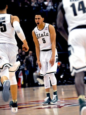 Michigan State senior guard Bryn Forbes (5) screams out after hitting a big three point field goal during the Big Ten Tournament Championship game, Sunday, March, 13, 2016 at Bankers Life Fieldhouse in Indianapolis.