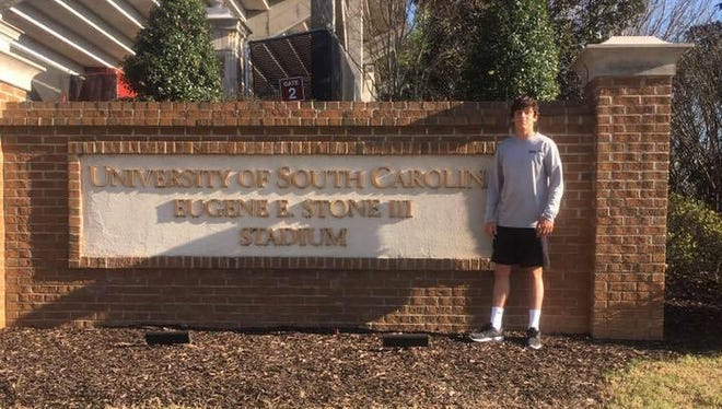 Asheville High senior Aidan O'Brien has committed to play college soccer for South Carolina.