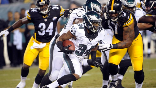 Eagles running back Henry Josey runs past Pittsburgh Steelers defensive lineman Nick Williams (67) during a preseason game at Lincoln Financial Field in Philadelphia. Josey is among  six players the team released on Friday. The Eagles will narrow the roster down to 53 today.