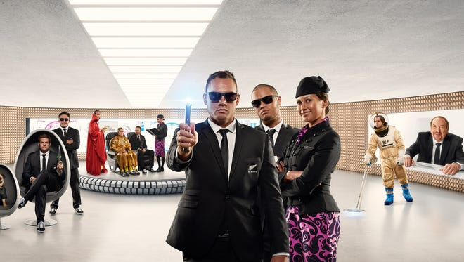 """An image promoting the new Air New Zealand """"Men in Black""""-themed safety video."""
