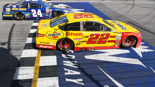 Jun 12, 2016; Brooklyn, MI, USA;  NASCAR Sprint Cup Series driver Joey Logano (22) and driver Chase Elliott (24) during the FireKeepers Casino 400 at Michigan International Speedway.