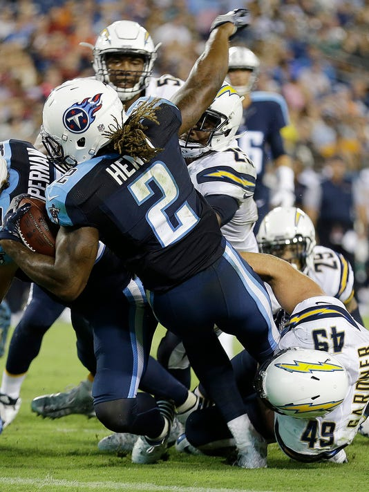 FILE - In this Aug. 13, 2016, file photo, Tennessee Titans running back Derrick Henry (2) runs into there end zone for a touchdown against San Diego Chargers linebacker Ben Gardner (49) during the first half of an NFL preseason football game, in Nashville, Tenn. New Titans general manager Jon Robinson has sifted through the roster adding 21 new players, revamping the offense through a handful of trades and showing the door to a handful of high draft picks from the previous regime. His biggest moves landed DeMarco Murray for coach Mike Mularkey's run-oriented offense and included trading the No. 1 overall pick netted more picks that help add Heisman Trophy winner Derrick Henry. (AP Photo/James Kenney, File)