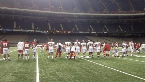 Alabama formed a wall of players to block the media from viewing practice Sunday in New Orleans