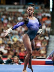 Trinity Thomas competes on the floor exercise during senior women's opening round of the U.S. gymnastics championships, Sunday, Aug. 20, 2017, in Anaheim, Calif. (AP Photo/Ringo H.W. Chiu)