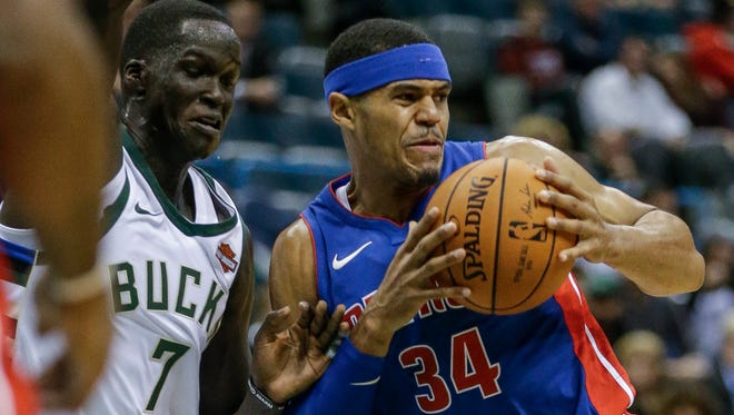 Bucks gaurd Thon Maker defends the driving Pistons forward Tobias Harris during the first half on Friday, Oct. 13, 2017, in Milwaukee.