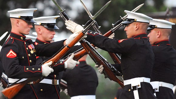 U.S. Marines with the Silent Drill Platoon perform during the Sunset Parade at the Marine Corps War Memorial in Arlington, Va., Aug. 4, 2009.