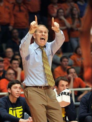 Michigan coach John Beilein shouts instructions during the second half of the overtime loss at Illinois Thursday.