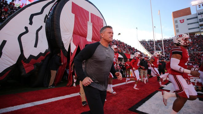 FILE - In this Nov. 11, 2017, file photo, Utah head coach Kyle Whittingham and Utah players take the field during an NCAA college football game against Washington State, in Salt Lake City. While the two Los Angeles teams adjust to new quarterbacks, and the Arizona teams break in new coaches, steady Utah has nine starters back on offense, including quarterback Tyler Huntley and running back Zack Moss. Not to mention continuity at the helm with coach Kyle Whittingham. (AP Photo/Rick Bowmer, File)