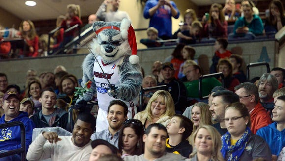 Skyforce mascot, Thunder dangles mistletoe over fans