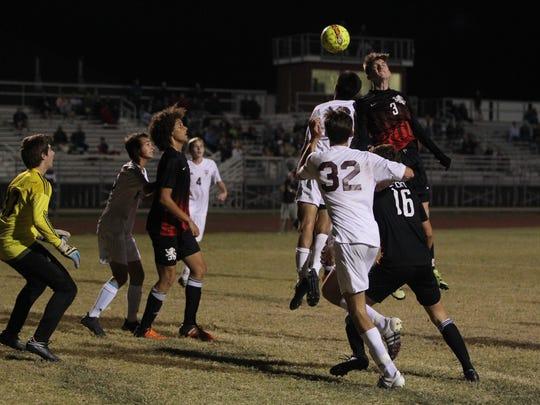 Leon's Tanner Powell heads a goal