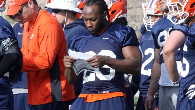 Injured UTEP running back Aaron Jones, center, attended Monday's first spring practice at Glory Field.