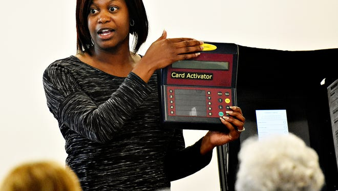York County Elections and Voter Registration Director Nikki Suchanic talks to poll workers about the card activator device during a training session at the Red Lion Area Senior Center in Red in 2015. Dawn J. Sagert photo