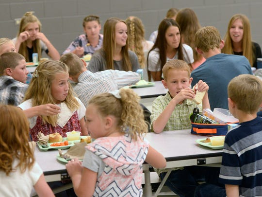 The entire student body and staff eat lunch together
