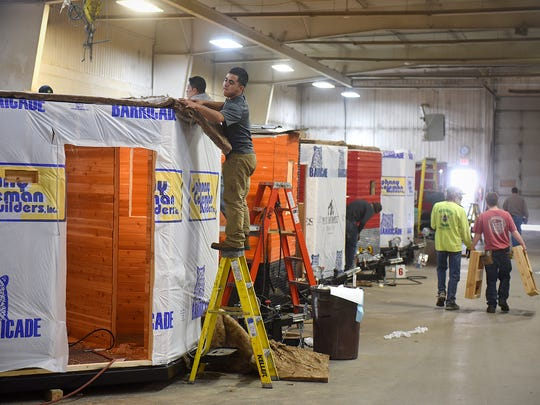 Workers complete various phases of construction on several fish houses Tuesday, Feb. 16, at the Ice Castle Fish Houses production facility in Montevideo. The most popular model is a 21-foot RV hybrid.