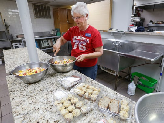 Cheryl Curtis volunteers in the kitchen at the Lives Under Construction Boys Ranch in Lampe, MO. She is part of an organization called Servants on Wheels Ever Ready out of Kansas that travels and volunteers in exchange for a place to hook up their RV's.