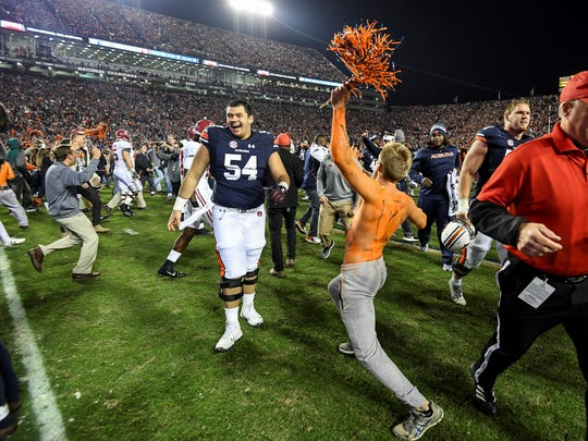Kaleb Kim (54) celebrates Auburn's upset win over Alabama last season.